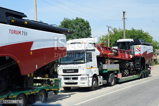 Stavropol, Russia - June 13, 2019: Transportation of combines on common roads.