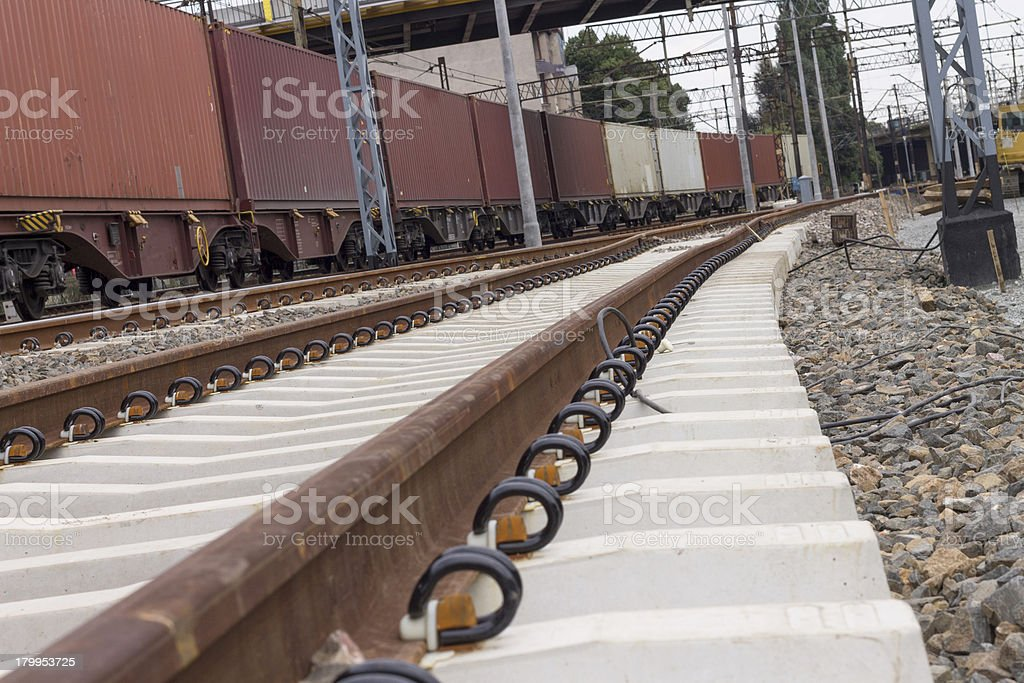 Transportation of goods by rail through the town stock photo