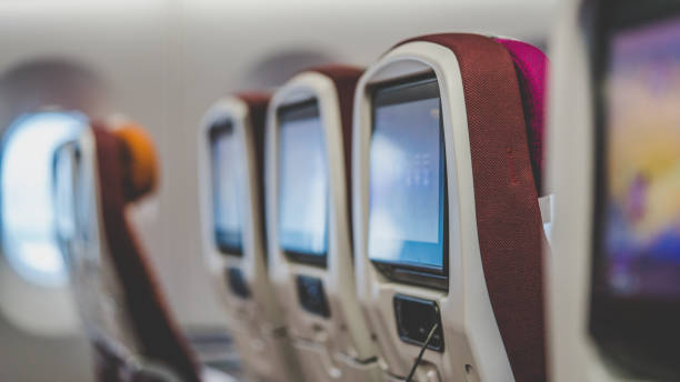 Transportation Photos Airplane Seat Back Screens airplane seat stock pictures, royalty-free photos & images