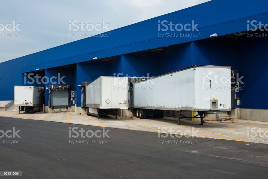Transportation service delivery station warehouse with trucks stock photo