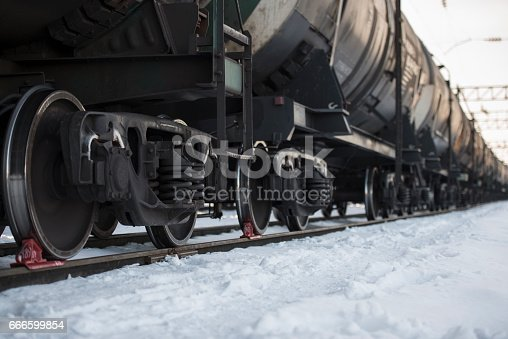 istock Transportation tank cars with oil in winter. 666599854