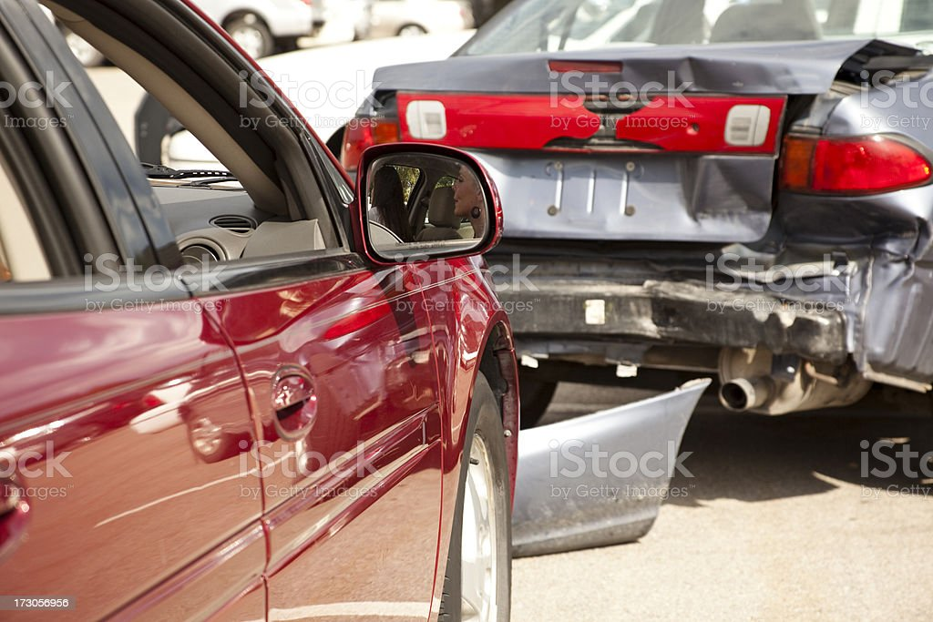 Transportation: Two-car accident, wreck with people still inside red vehicle. stock photo