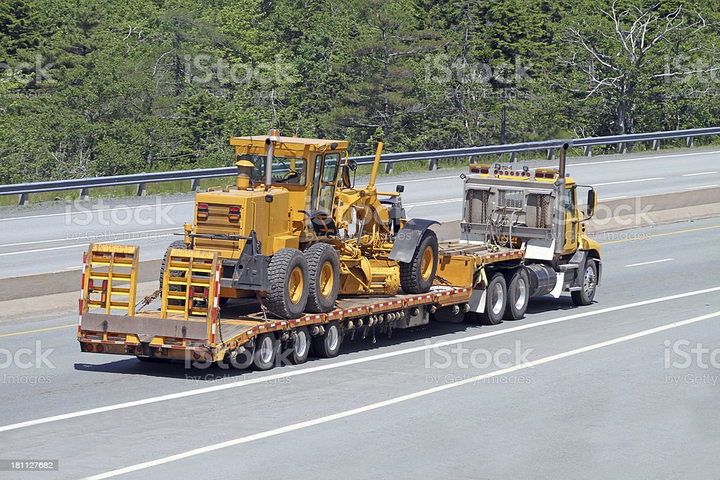 Transporting A Road Grader royalty-free stock photo