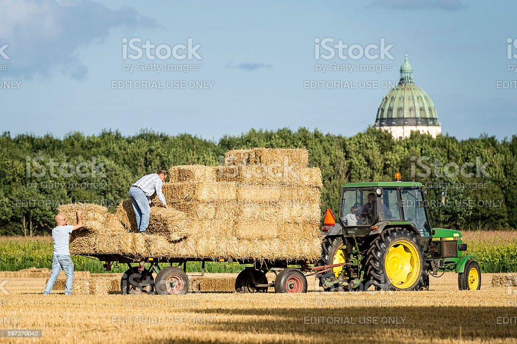 Transporting bales of hay with a tractor royalty-free stock photo