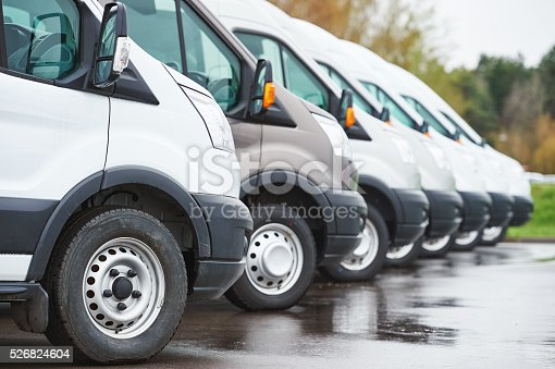 istock transporting service company. commercial delivery vans in row 526824604