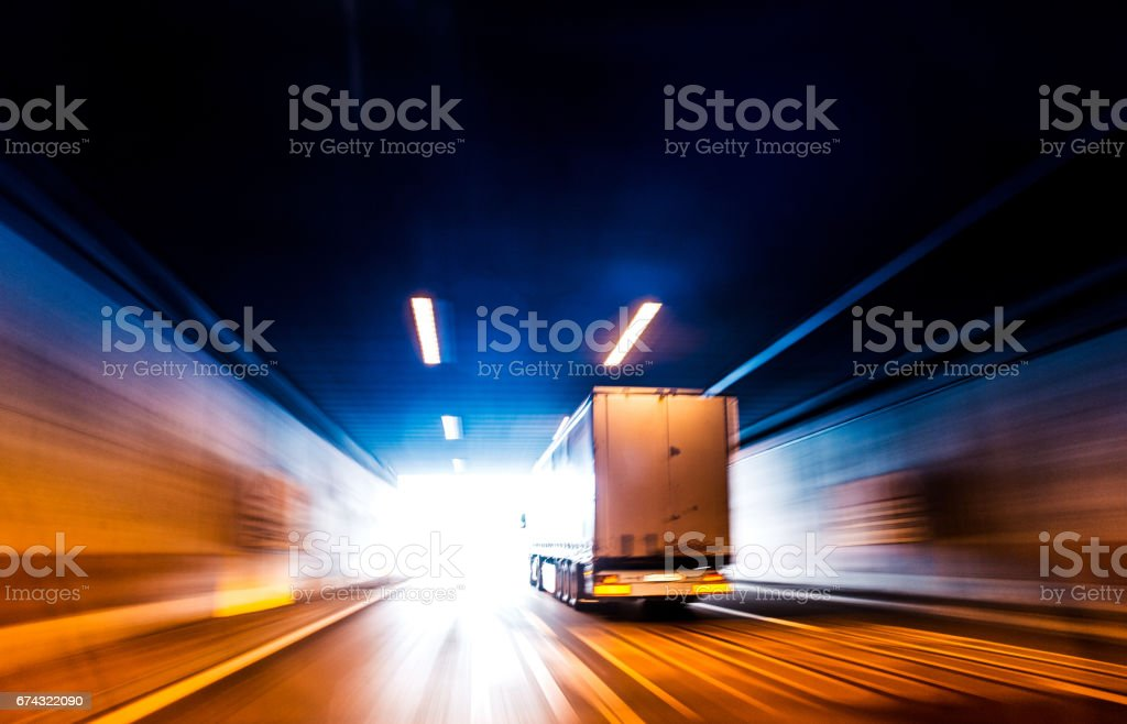 Transports Truck Driving in Tunnel stock photo