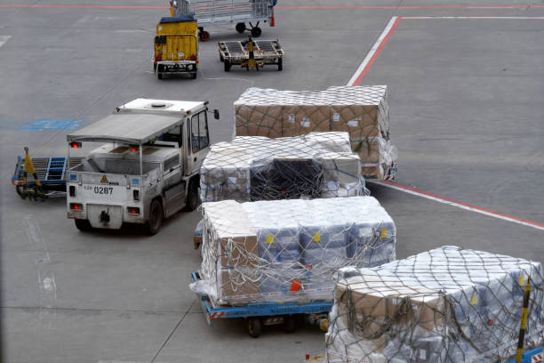 Transshipment of baggage on the airport tarmac stock photo