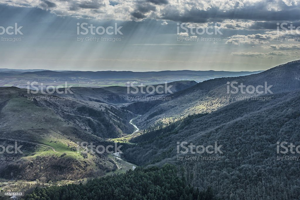 Transylvania landscape winding river sun beams stock photo