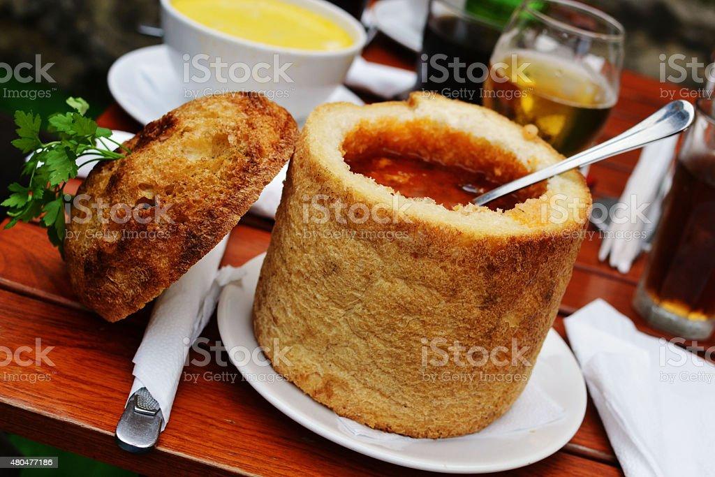 Transylvanian beans soup in bread. stock photo