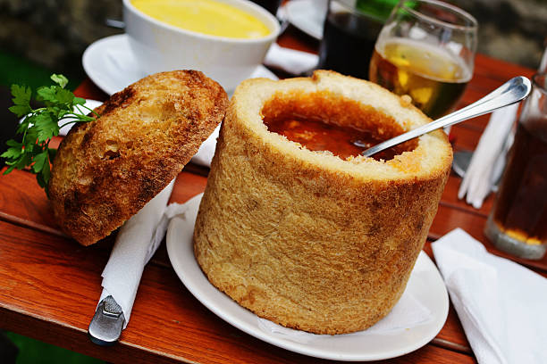 transylvanian beans soup in bread. - romania stock pictures, royalty-free photos & images