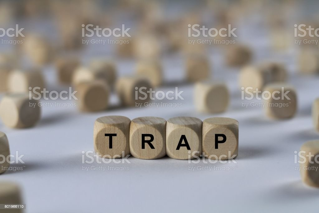 trap - cube with letters, sign with wooden cubes stock photo