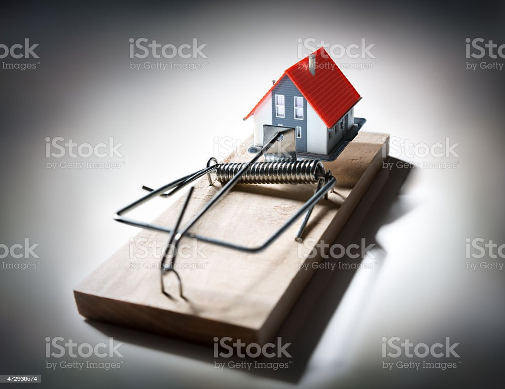 trap estate - risk of mortgage on house stock photo