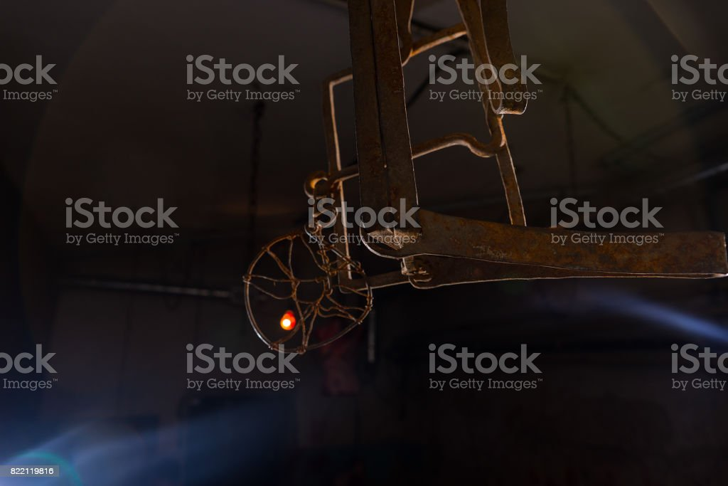Trap hanging in dimly lit basement in a Halloween concept stock photo