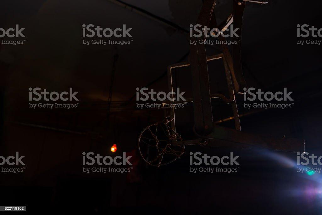 Trap hanging in dimly lit basement stock photo