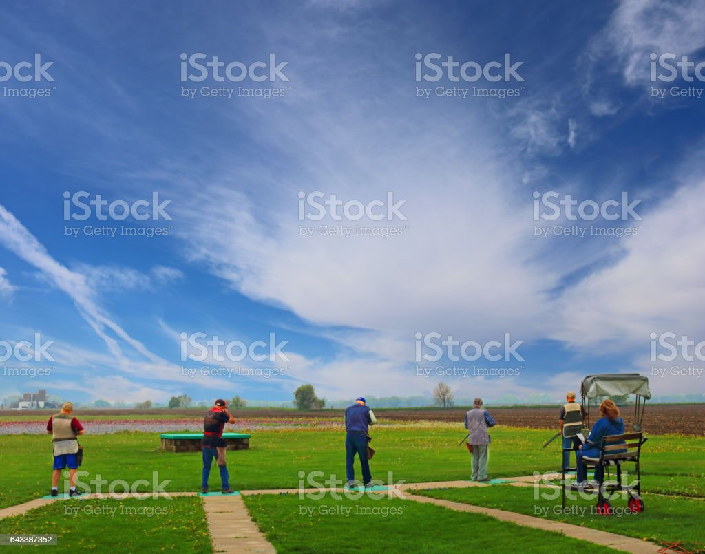 trap shooters stock photo
