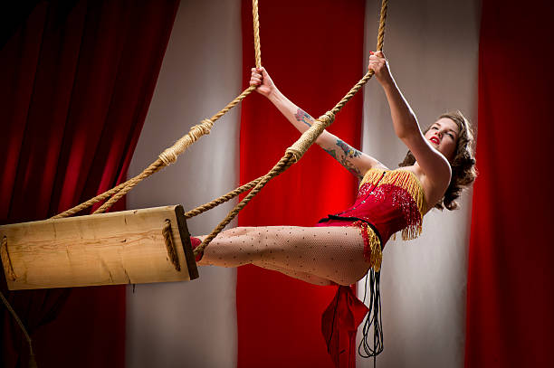trapeze artist - burlesque stock photos and pictures