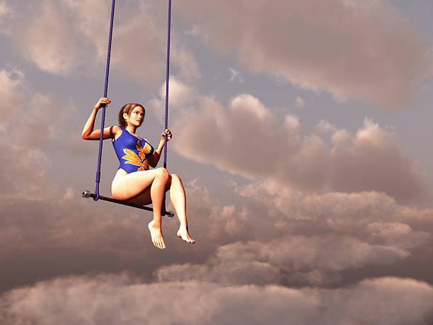 ausgestelltes frau in den wolken - trapez stock-fotos und bilder
