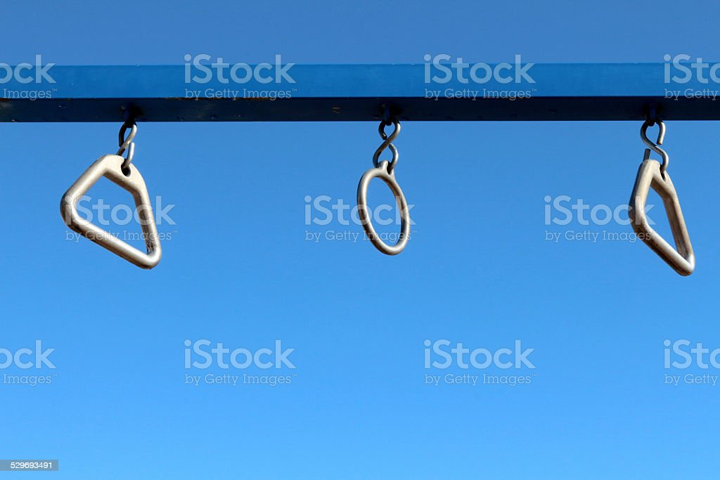 Trapezoid and circular trapeze rings at a park stock photo
