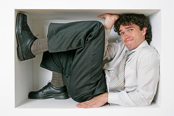 trapped businessman - claustrofobie stockfoto's en -beelden
