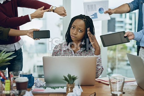 1067846662 istock photo Trapped by unending work tasks 854972470