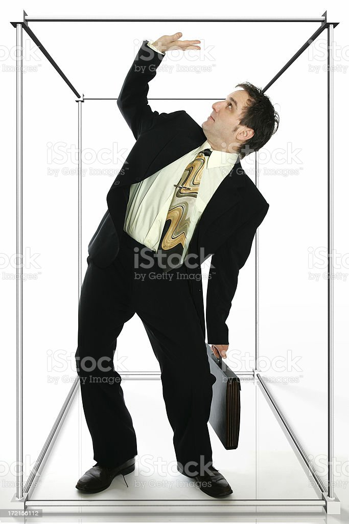 Trapped in a cubicule stock photo