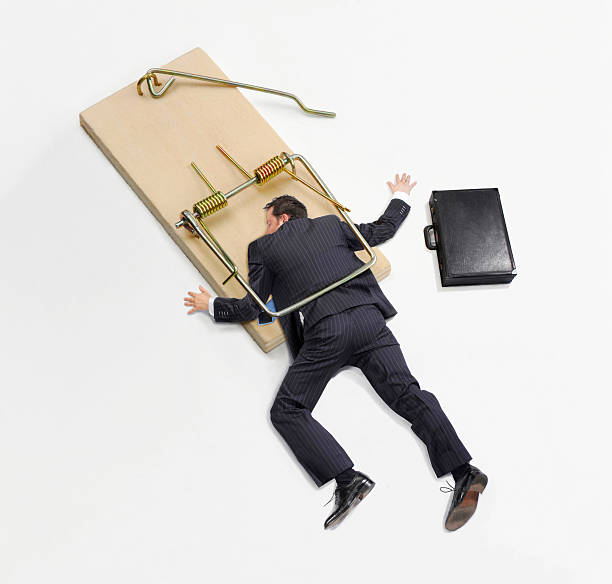 Trapped on work. Businessman trapped on mousetrap on white background. trap stock pictures, royalty-free photos & images