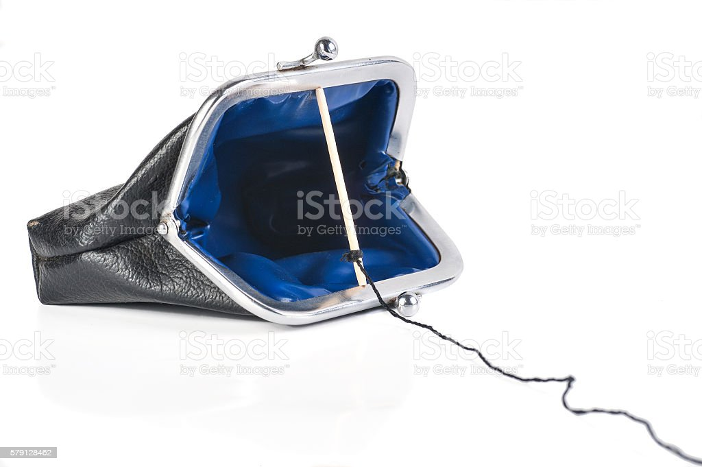 Traps for money in open purse stock photo