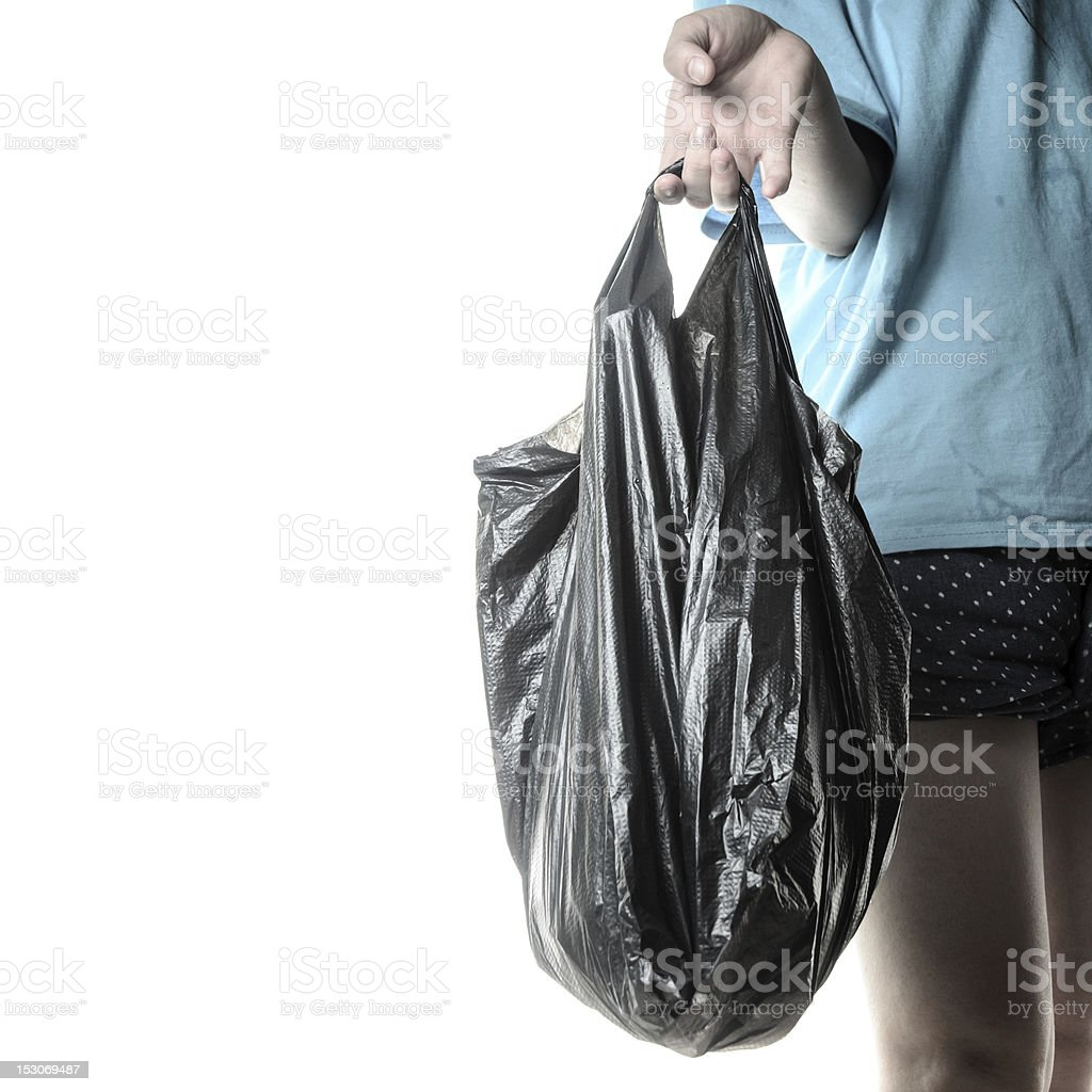 trash bag in hand royalty-free stock photo