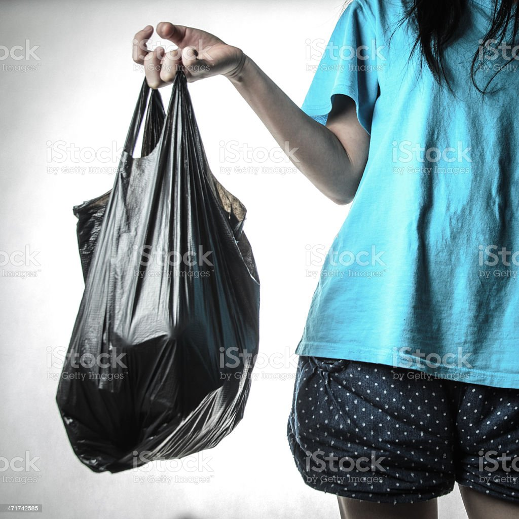 trash bag in hand stock photo