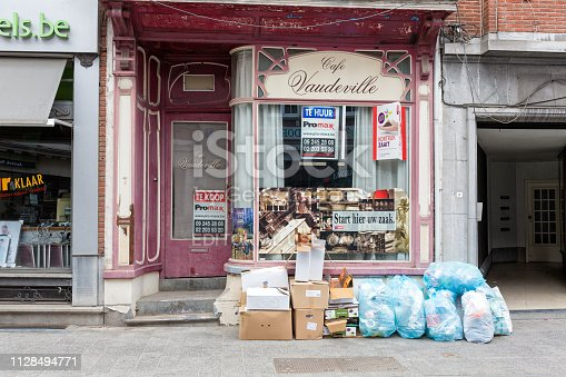 Kortrijk, Belgium - May 2018. Housing front with recycle trash bags ready to be picked up in the center of Kortrijk.