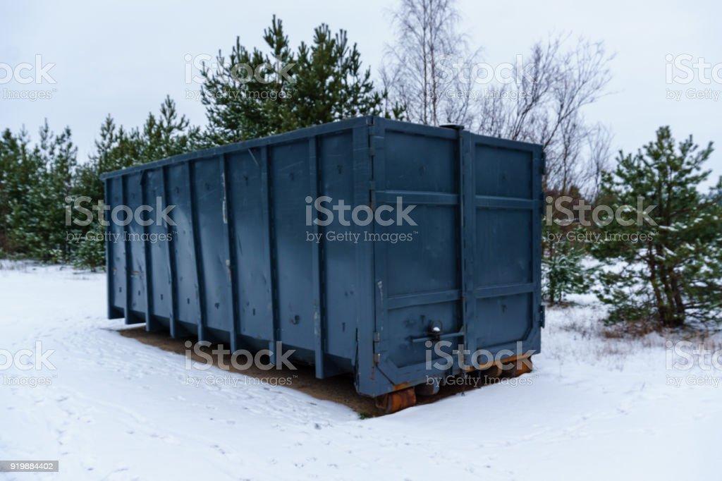 Trash bin at the side of street in winter stock photo