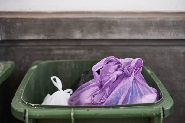 Trash bin with bags stock photo