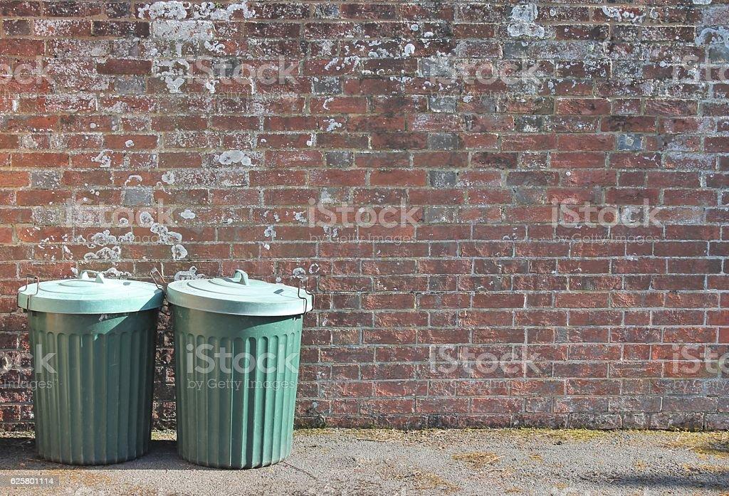 trash can dustbin trashcan rubbish bins brick wall copy space stock photo