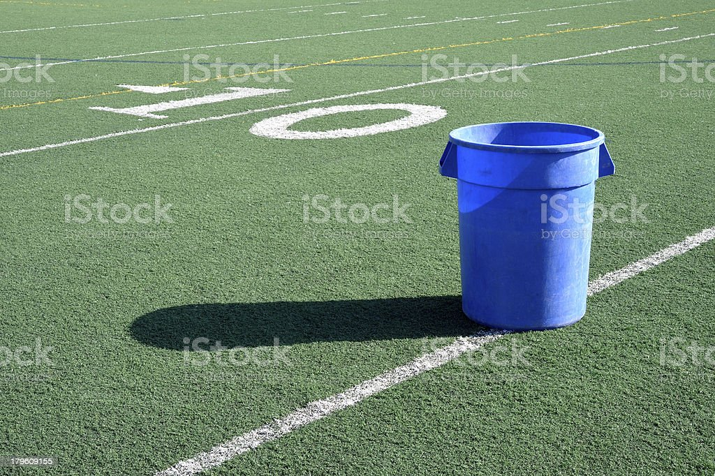 Trash can on a football field royalty-free stock photo