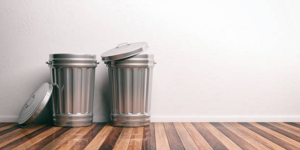 Trash cans on a wooden floor 3d illustration stock photo