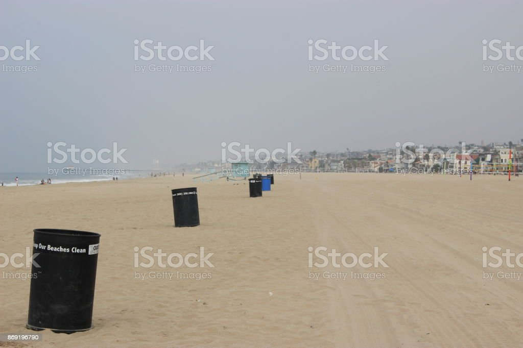 trash cans on the beach stock photo