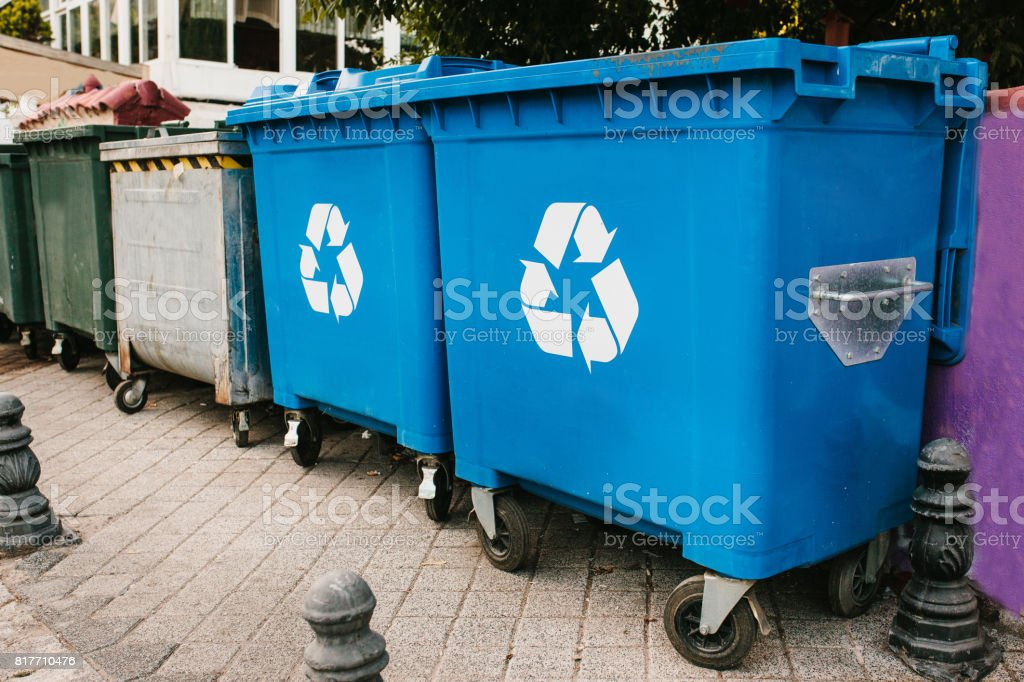 Trash cans standing in a row stock photo