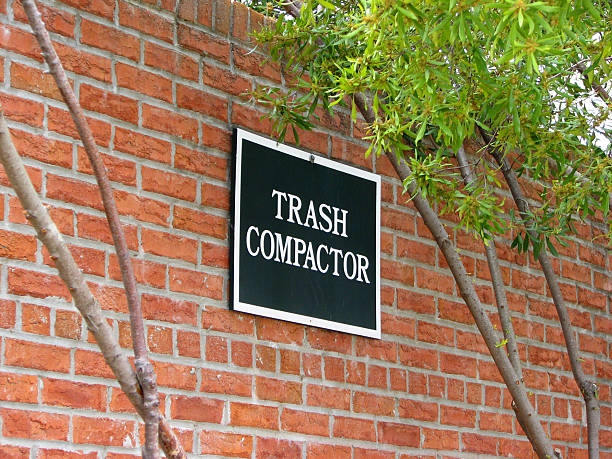 Trash Compactor Sign  compactor stock pictures, royalty-free photos & images