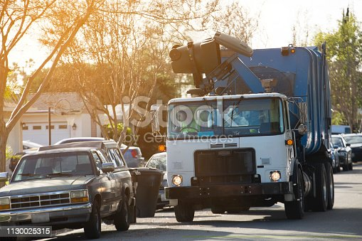 Garbage truck trash collection.