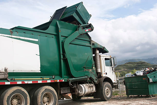 trash dumpster pickup - garbage bin stock photos and pictures