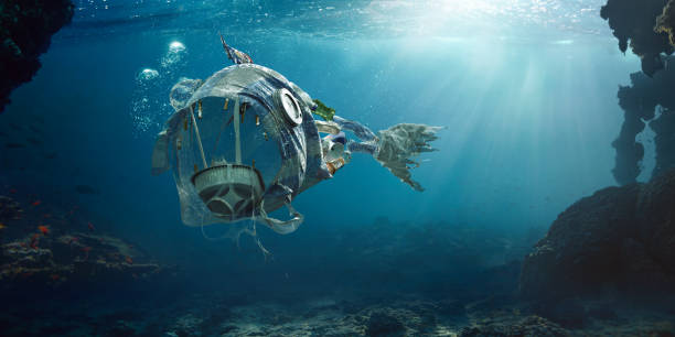 trash in sea in shape of open mouthed monster fish - ocean plastic stock pictures, royalty-free photos & images