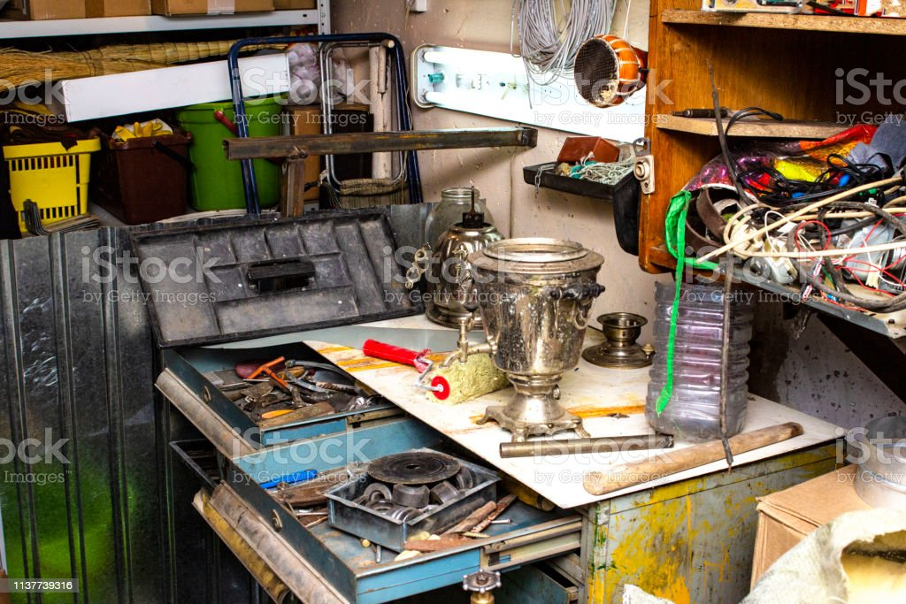 Trash In The Garage Piled Up Different Old Things Stock Photo Download Image Now Istock