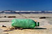Plastic bottle on the sand on a beach in southeastern Brazil