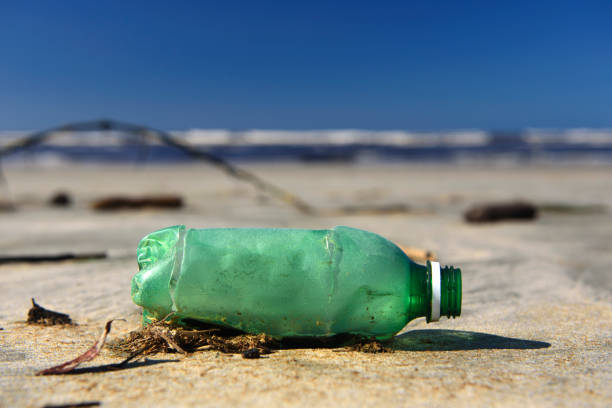 trash in the sea - ocean plastic stock pictures, royalty-free photos & images