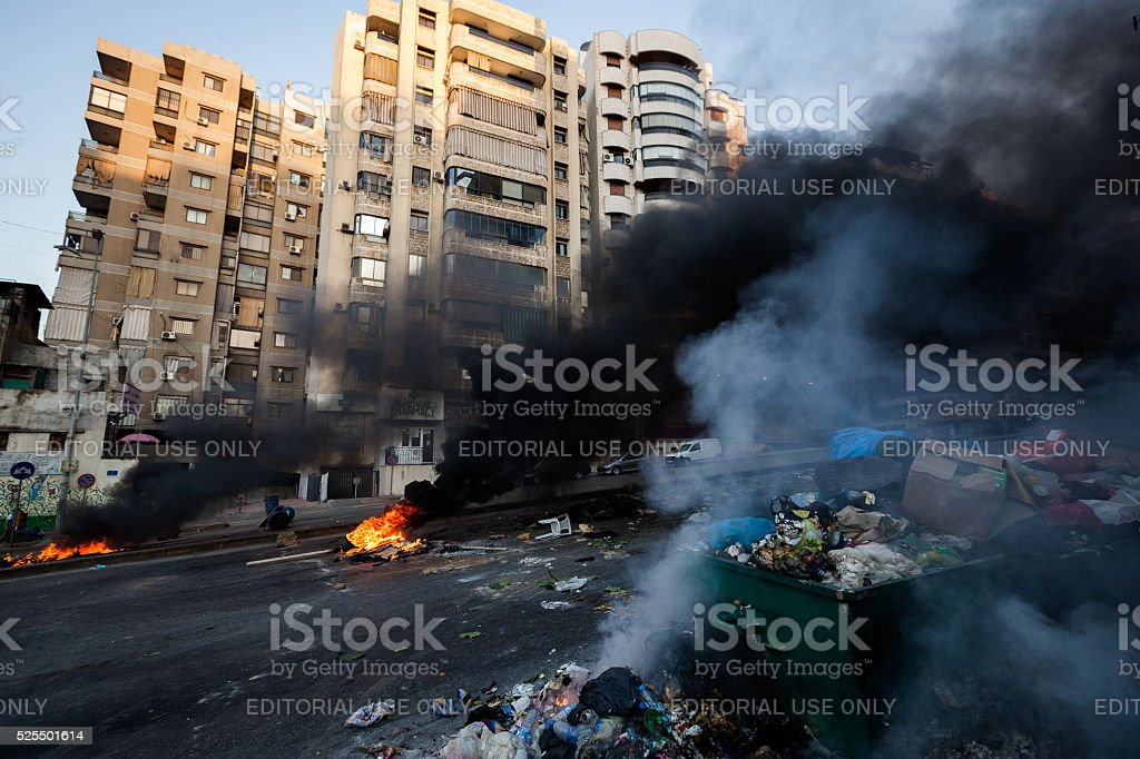 Trash on fire in central Beirut, Lebanon. stock photo