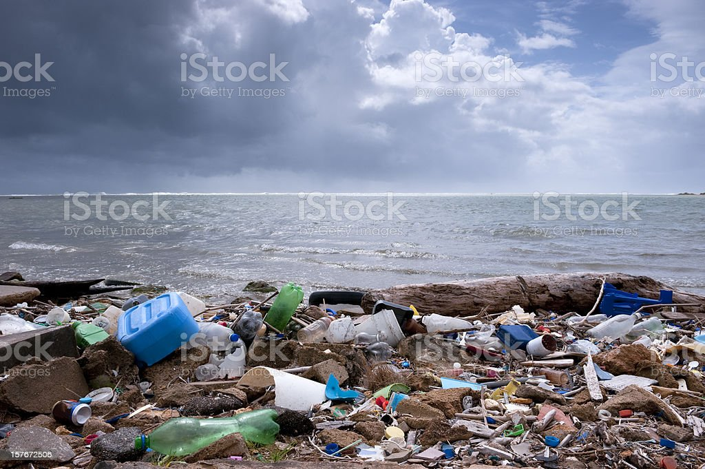 trash on the beach stock photo