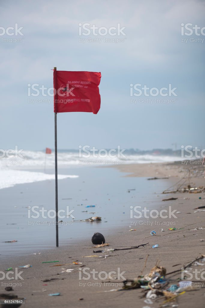 Trash washed up on beach in Seminyak, Bali stock photo