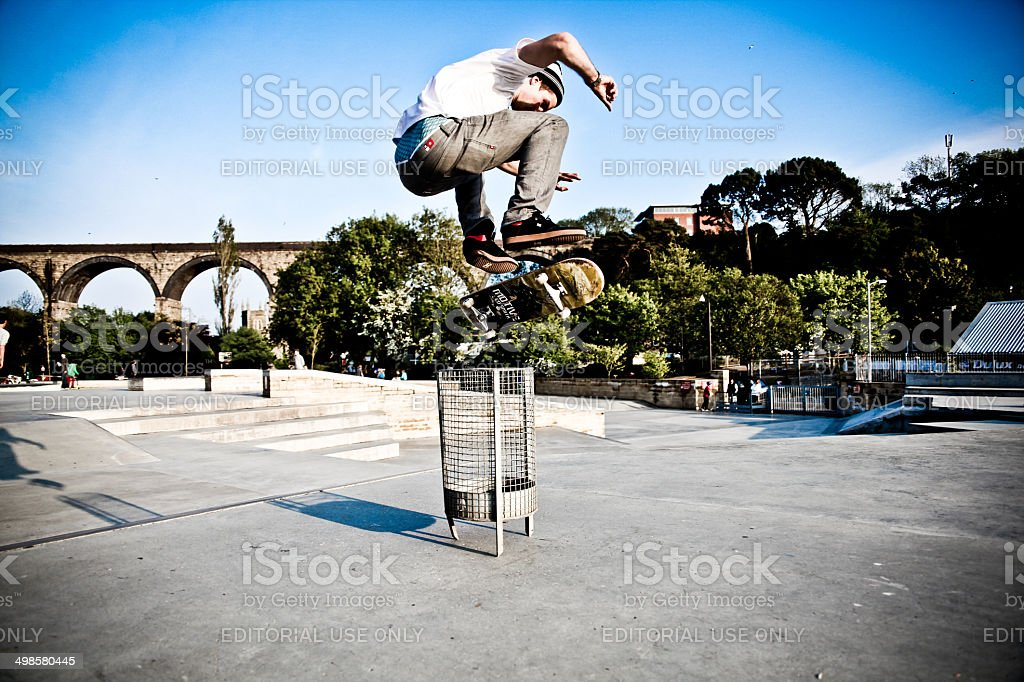Trash-Can Kick-Flip stock photo