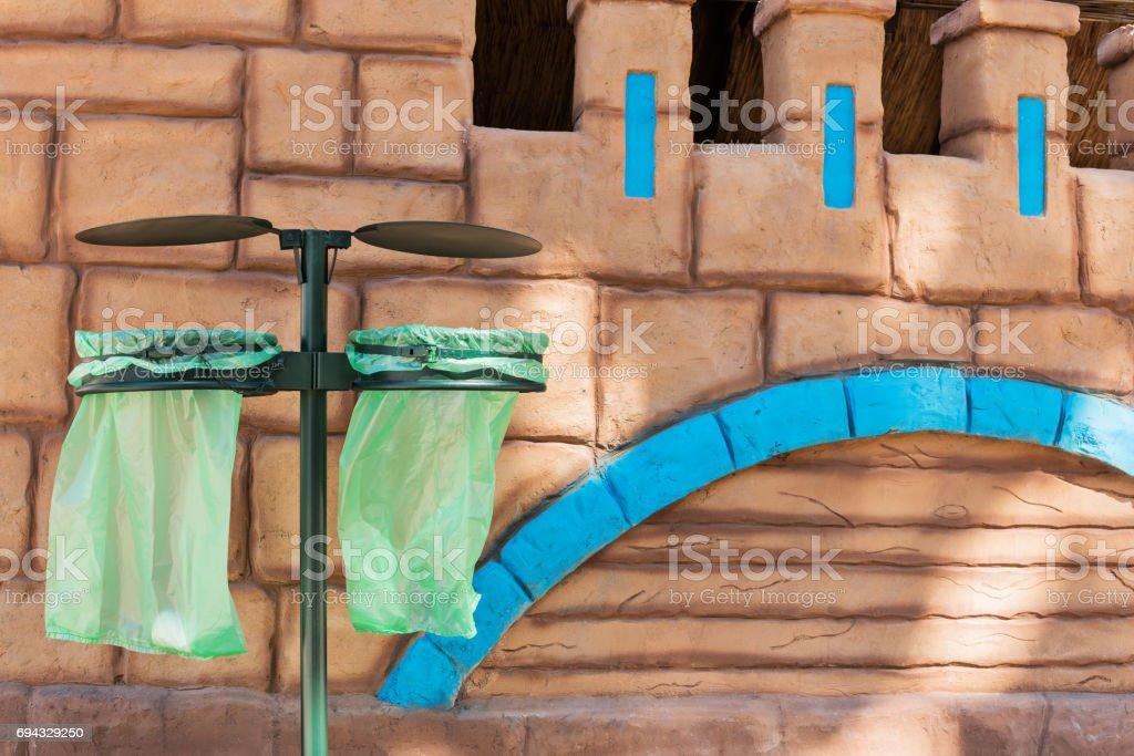 Trashcan near the castle walls stock photo