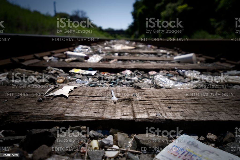 Trash-strewn railroad track used by drug addicts stock photo
